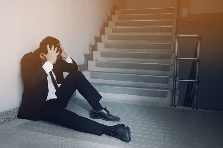 Man sitting on staircase