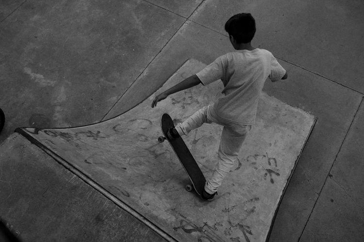 High angle view of girl playing on floor