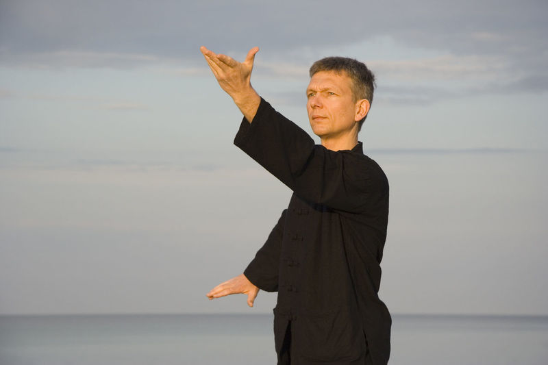 tai chi - posture wild horse parts mane left- art of self-defense Balance Energy Exercise Fitness Healthy Healthy Lifestyle Man Martial Arts Mature Man Mature Men Meditation Movement One Man Only One Man Only. Qi Gong Sea Sports Clothing Tai Chi Tai Chi Chuan Taiji Taijiquan Training Waist Up Yingyang Zen