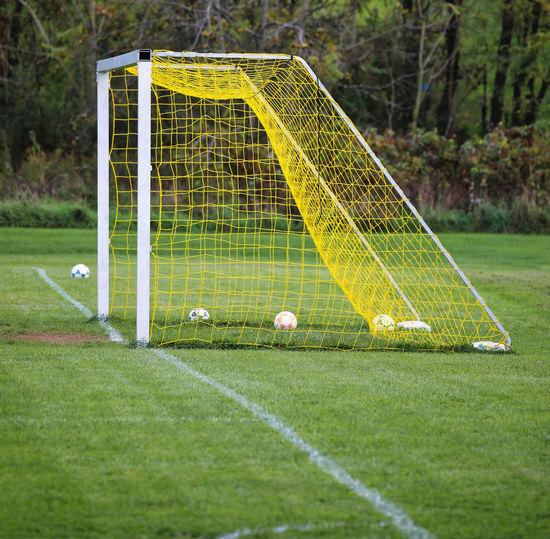 Green soccer ball on field