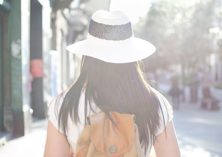 Travels. Hat Rear View One Person Sun Hat Real People Lifestyles Outdoors Women Focus On Foreground Fashion Sunlight Day Leisure Activity City Architecture Young Adult Close-up Adult People Holiday Backpacking