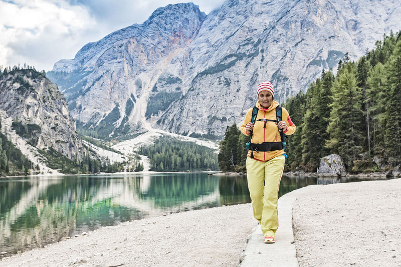Woman hiking at the lake Alps Alto Adige Braies Braies Lake Bruneck Enjoy Girl Hike Hiker Hiking Holiday Lake Leisure Activity Mountain Mountains Nature Outdoors Prags Pragser Wildsee Recreation  Scenics Single Südtirol Walking Woman