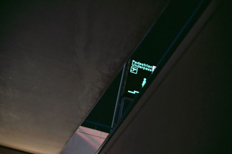 Low angle view of text on wall at night