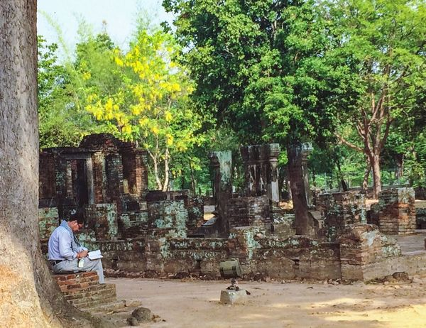 Sukhothai,Thailand - April 19 : Unidentified A man reading a book in Wat Srichum in Sukhothai,Thailand The Week Of Eyeem historical Sukhothai Historical Park EyeEmNewHere T The Week Of Eyeem Historical Sukhothai Historical Park EyeEmNewHere Tree Plant Real People Growth Day Nature Men Sunlight Outdoors Leisure Activity Lifestyles Architecture Full Length Built Structure One Person Sitting Vertebrate Women Park