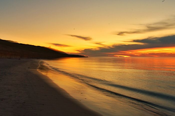 Sunset Nature Scenics Beauty In Nature Orange Color Tranquil Scene Tranquility Sky Beach Sea Sand Outdoors Water No People Sun Day Landscape Horizon Over Water