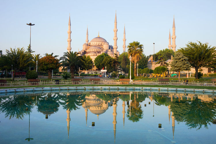 Dawn at the Blue Mosque with reflection in water, Istanbul, Turkey Blue Mosque Historical Building Istanbul Morning Ottoman Ottoman Empire Pond Sultan Ahmed Mosque Sultanahmet Turkey Architecture Building Exterior Built Structure Dawn Landmark Minarets Monument Park Place Of Worship Reflection Religion Tourism Travel Travel Destinations Water