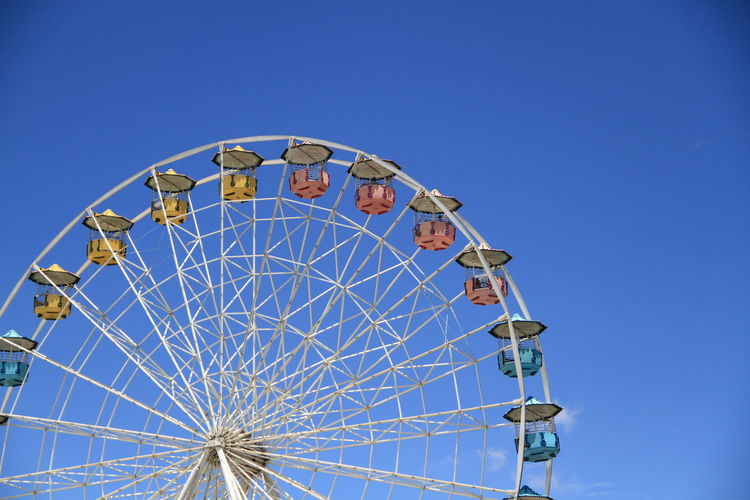 Amusement Park Amusement Park Ride Arts Culture And Entertainment Blue Clear Sky Ferris Wheel Leisure Activity Low Angle View