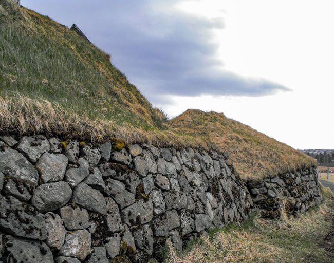Ancient Icelandic Houses Rock - Object Hill Rural Scene Grass Sky Cloud - Sky Landscape Day No People Outdoors Green Roof Turf Houses Turf Roof Stone House Traditional Arctic Iceland Vernacular Architecture Architecture Building Exterior Buildings History