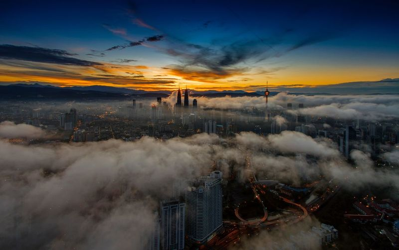 Aerial view kuala lumpur city during sunrise Sunset Beauty In Nature Kuala Lumpur Malaysia  Kuala Lumpur City Center Aerial View Aerial Photography Aerial Shot View From Above Drone  KLCC Twin Towers KL TOWER Travel Cityscapes Aerial View Of City