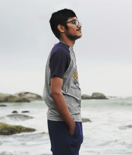 Side view of young man looking away