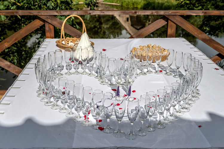 Wedding table decoration. Heart-shaped arranged champagne glasses. Close-up Day Heart Shape Luxury No People Outdoors Table Wedding Wineglass