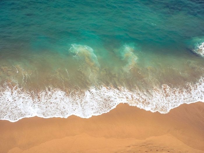The surf on the beach in Sagres from above Portugal Sagres Ocean View Ocean From Above  Surf Land Sea Motion Water Nature Beauty In Nature Beach Wave Sand Surfing Aquatic Sport Scenics - Nature Sport Outdoors Splashing Environment Landscape Power In Nature
