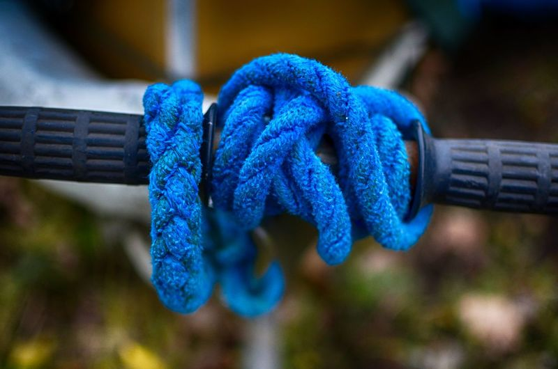 Close-up of blue ropes tied to handle