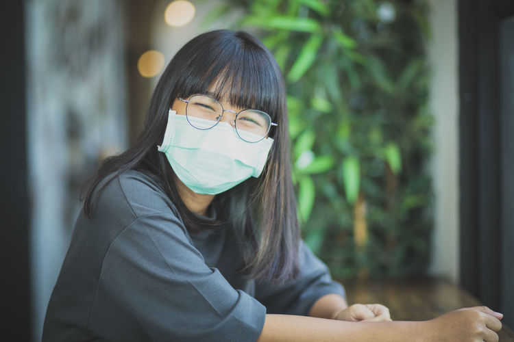 Portrait of smiling teenager girl wearing mask