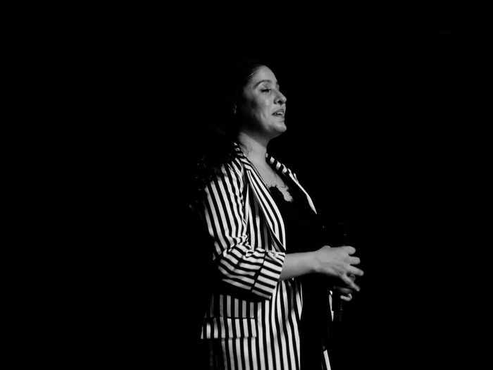 El Concierto Singer  Concert Concert Photography Candid Mobilephotography Blackandwhite Singing Stage Performance Event EyeEm Selects Black Background Women Human Hand