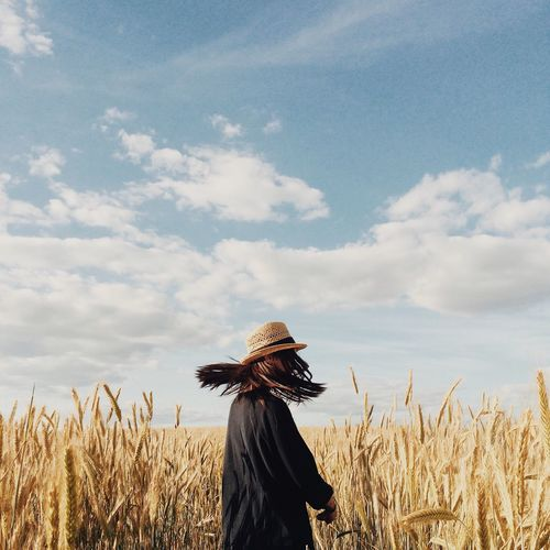 Field Agriculture Growth Cereal Plant Sky One Person Crop  Farm Cloud - Sky Nature Standing Women Rural Scene Day Plant Real People Wheat Lifestyles Outdoors Young Women Sommergefühle