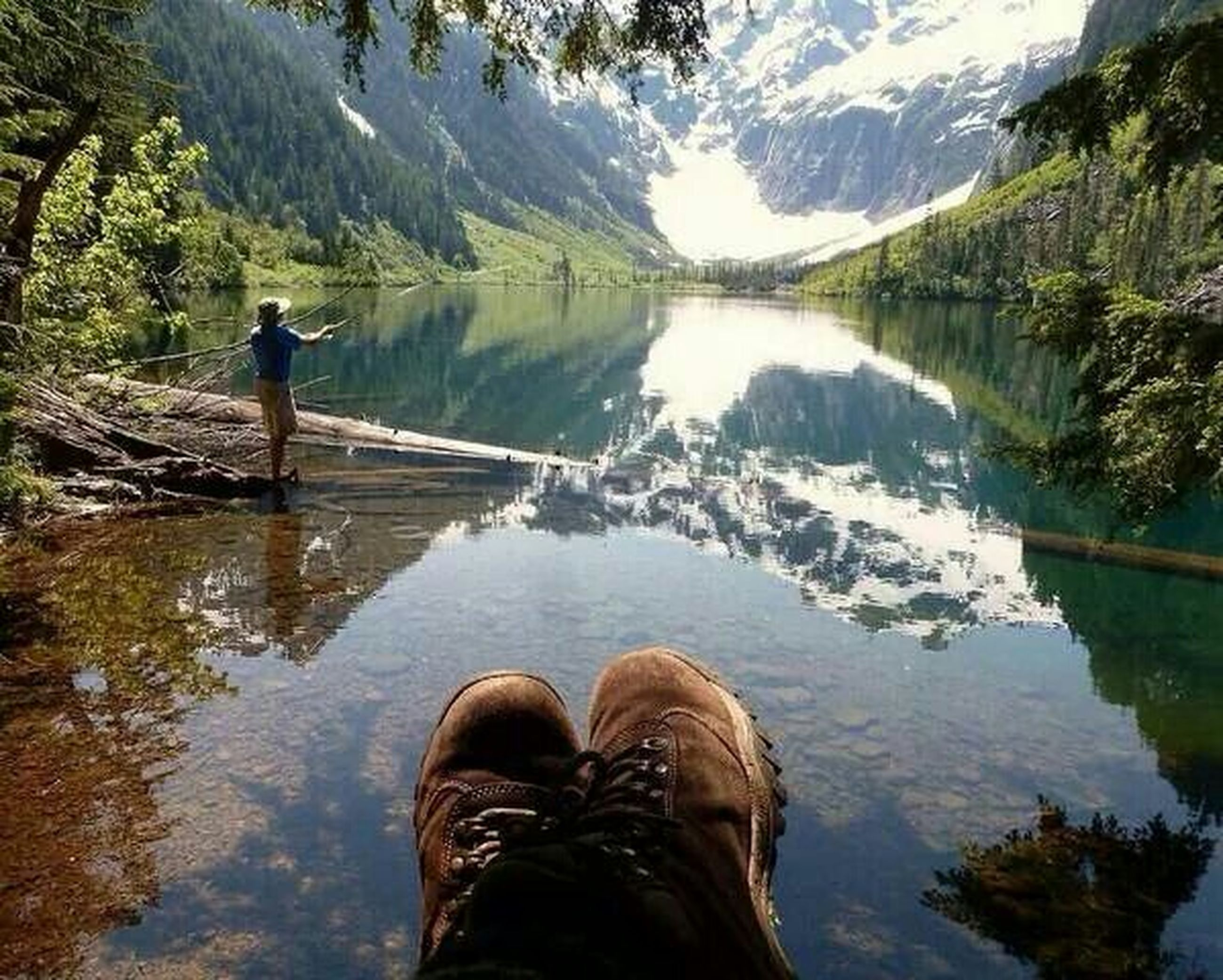water, lake, reflection, low section, person, standing, lifestyles, men, tranquility, leisure activity, shoe, river, nature, tranquil scene, personal perspective, scenics, mountain, beauty in nature