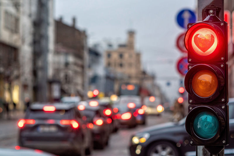 A city crossing with a semaphore, traffic light with red heart-shape in semaphore, valentine day
