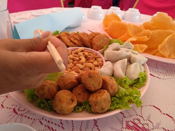 High angle view of hand holding food on table
