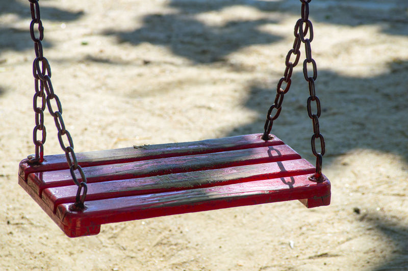 Close-Up Of Empty Swing In Playground