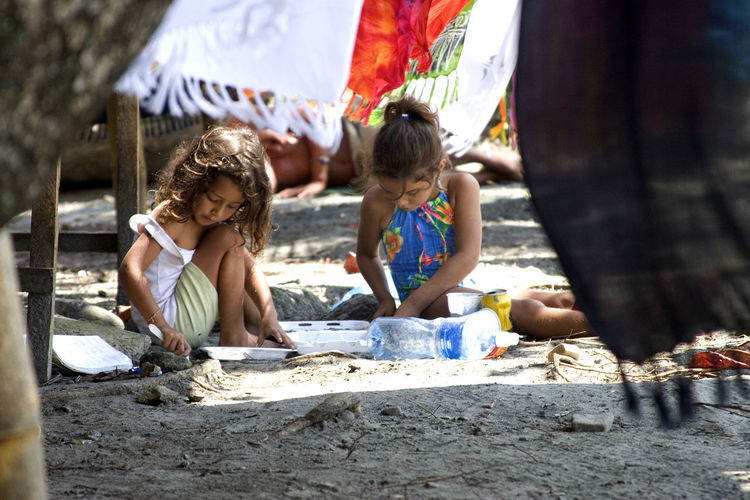 Absorbed In Play Costa Rica Beaches Gentle Breeze Girls Playing With Sand Leisure Activity Sunny Day The Essence Of Summer