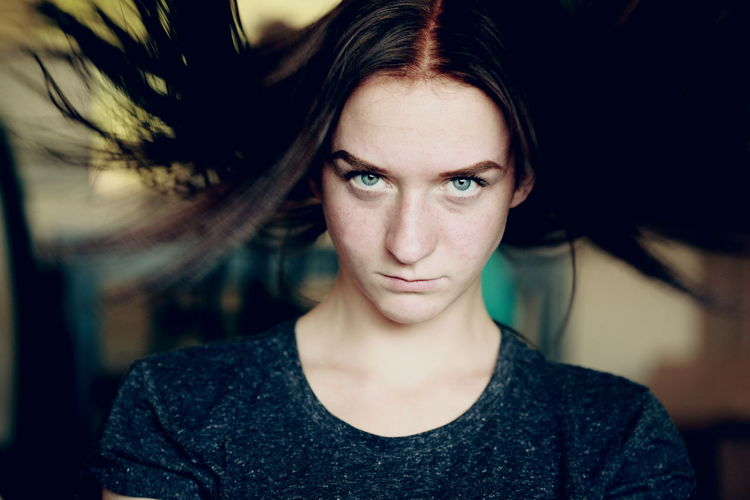 Portrait Of Angry Young Woman At Home