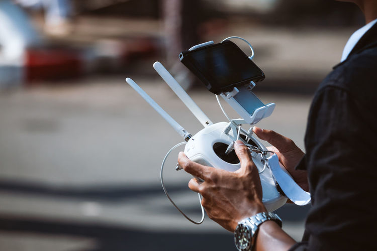 Man holding drone remote controller
