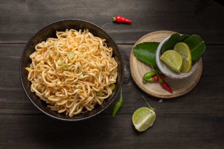 Chili  Close-up Cuisine Food Food And Drink Food Photography Food Preparation Food Stylist Healthy Eating Instant Noodles Lemon Lifestyles No People Noodles Noodles Time Noodlesoup Studio Shot Table Tablet Wood Wood - Material Wood Table