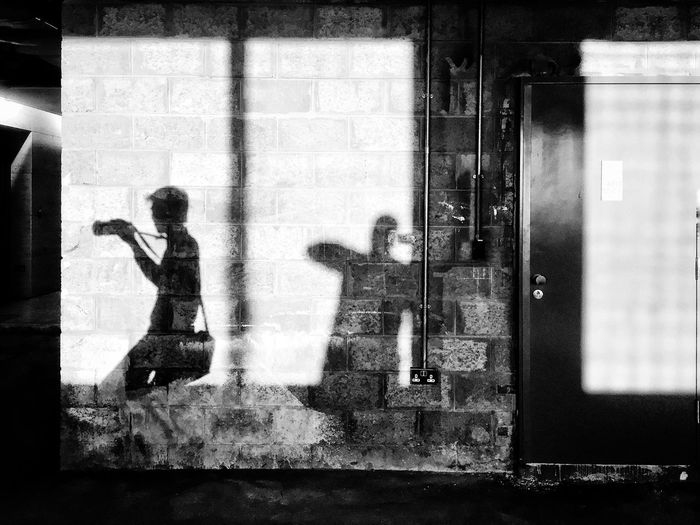 Shadow of photographer on wall