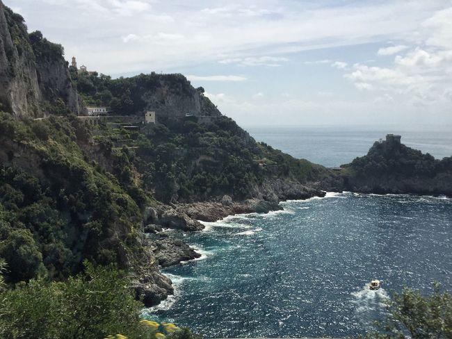 The beautiful Costiera Amalfitana Conca Dei Marini Amalfi Coast By The Sea Seafront Turquoise Water Rocky Shoreline Italy Showcase June