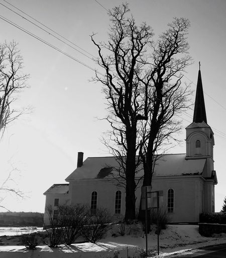 EyeEmNewHere Bare Tree Tree Winter Snow Architecture Building Exterior Built Structure Religion Spirituality Place Of Worship Sky Branch Outdoors Nature No People Low Angle View Day Beauty In Nature Lost In The Landscape
