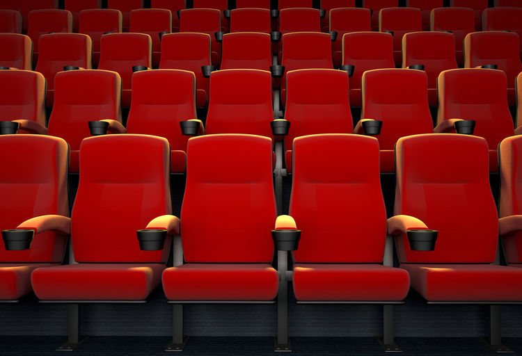Full frame shot of red empty seats in row at movie theater
