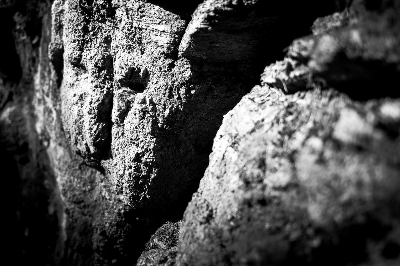 textured, selective focus, close-up, no people, rough, day, full frame, solid, old, rock, backgrounds, history, weathered, pattern, outdoors, run-down, nature, the past, rock - object, architecture, deterioration