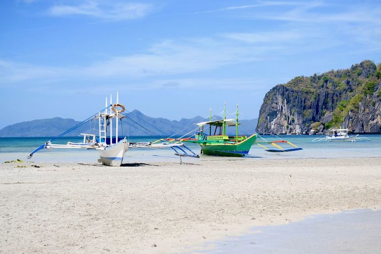 Sky Beach Sand Bay Sailboat Mountain Outrigger Boat Beauty In Nature Tranquil Scene El Nido, Palawan El Nido Islands Ebb Low Tide Canoe Outrigger Canoe Outrigger Palawan Island Bangka Bacuit Archipel Philippine Beaches Philippine Islands Outdoors No People Moored Tranquility Nature Scenics - Nature Sea Mode Of Transportation Transportation Water Nautical Vessel It's More Fun In The Philippines Island View  Island Vacation Wooden Boat Boat Trip