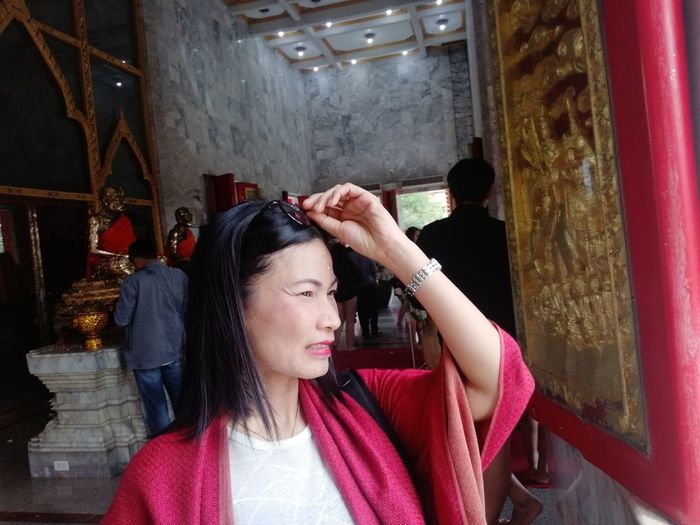 Smiling mature woman looking away in temple