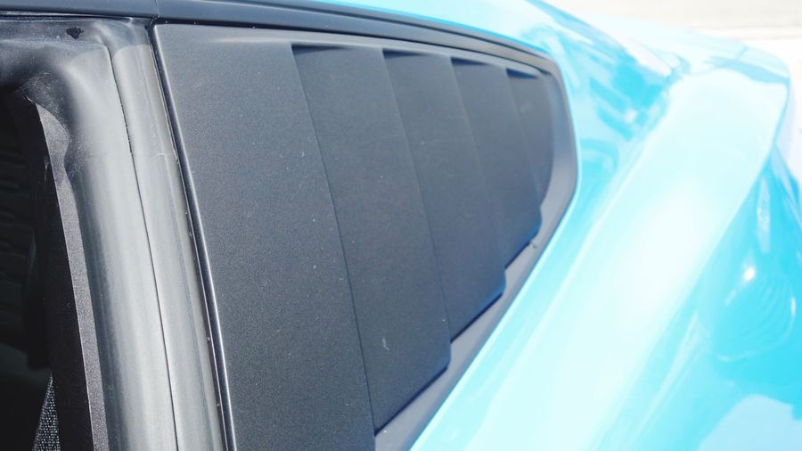 Window Covers Blue Car Close Up