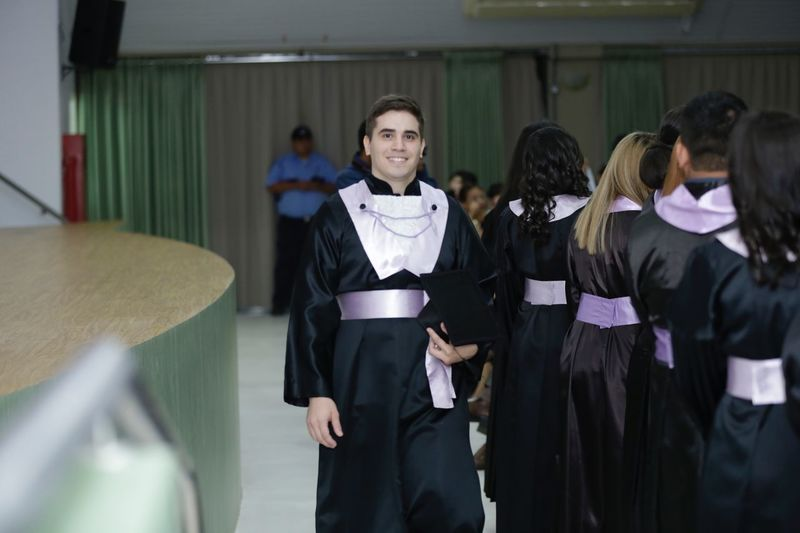 Portrait of man in graduation gown