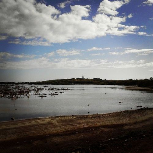 The lighthouse past the marsh! Seawaterlagoon Marsh Lighthouse Sky clouds losmorrillos caborojo puertorico
