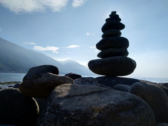 Rock Solid Balance Rock - Object Sky Stack Stone - Object Pebble Stone Zen-like Tranquility Tranquil Scene Nature Beauty In Nature No People Water Scenics - Nature Mountain Outdoors Lake