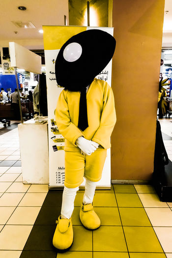 Wear Disguise Masquerade Party Paint The Town Yellow The Week On EyeEm Day Full Length Indoors  Masquerade Masquerade Mask Masquerademasks One Person People Real People Retail  Standing Store Streetphotography Yellow Done That. The Street Photographer - 2018 EyeEm Awards