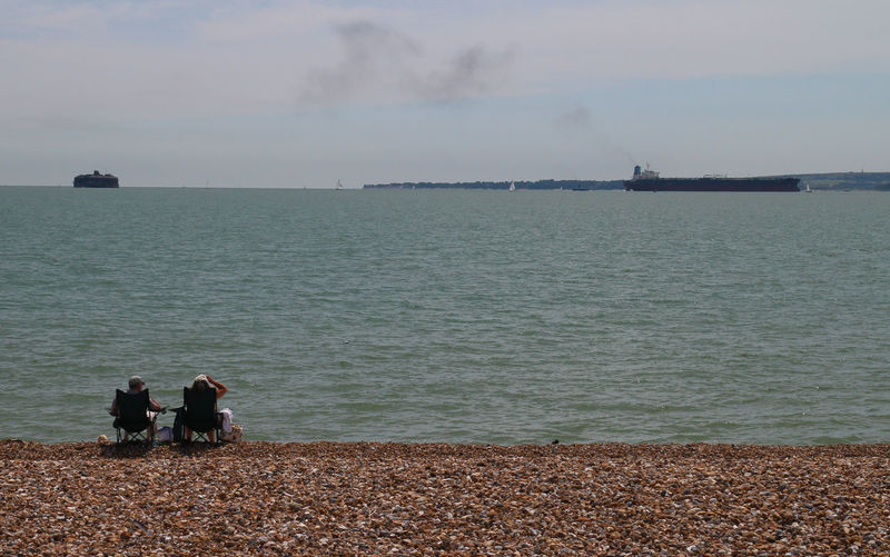 Adult Beach Beauty In Nature Day Friendship Horizon Over Water Isle Of Wight  Leisure Activity Lifestyles Lounging Men Nature Outdoors People Real People Scenics Sea Shipping Lane Sky Standing Togetherness Two People Vacations Water Women