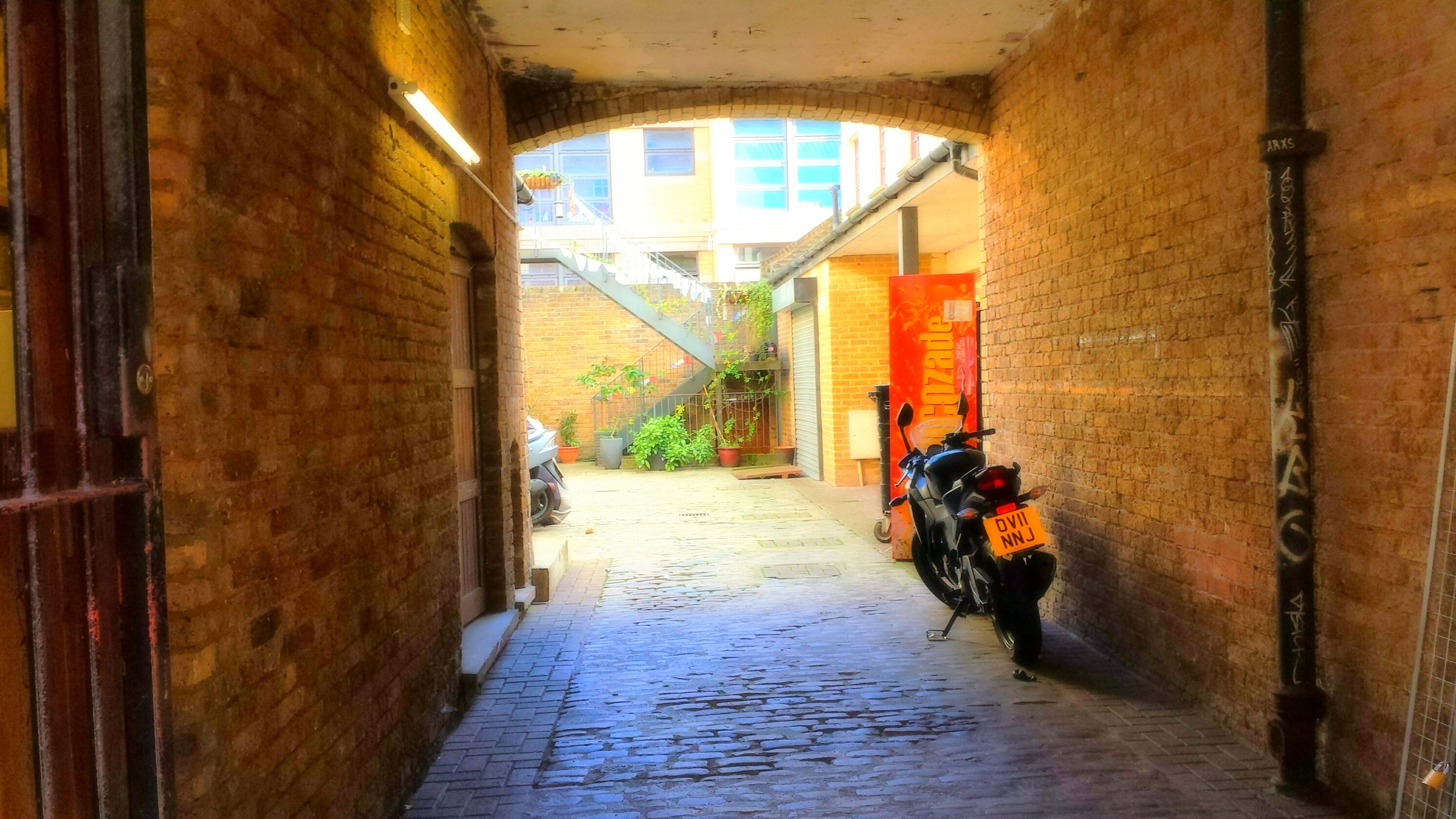 architecture, the way forward, built structure, narrow, building exterior, corridor, indoors, diminishing perspective, arch, alley, building, door, walkway, house, vanishing point, residential structure, pathway, empty, wall - building feature, long
