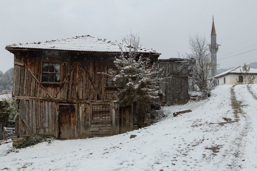 view of the village of Sünnetköy in the Bolu mountains of Turkey Architecture Bolu  Building Buildings House Minaret Mosque Mountains Road Snow Snow ❄ Sünnetköy Tree Turkey View Village Village View Wooden House