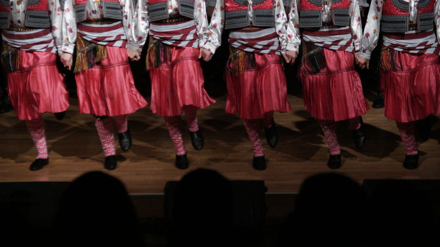Group Of People Performance Clothing Arts Culture And Entertainment Performing Arts Event Red Standing In A Row Indoors  Low Section Dancing Adult Traditional Clothing Hanging Fashion Real People People Coordination Dress Crowd Stage Traditional Dancing