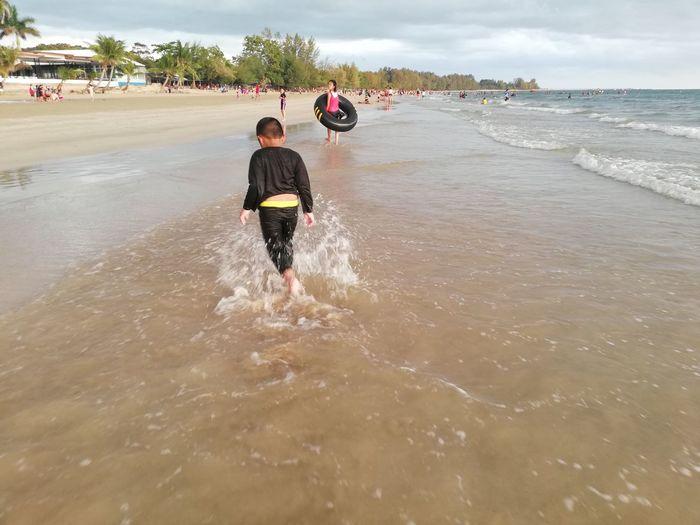 Children enjoy on summer trip 2019,หาดเจ้าหลาว Achi2019 Water Sea Motion Beach Rear View Real People Lifestyles Sport Men Childhood Land Leisure Activity Wave Nature People Males  Child Full Length Aquatic Sport Outdoors