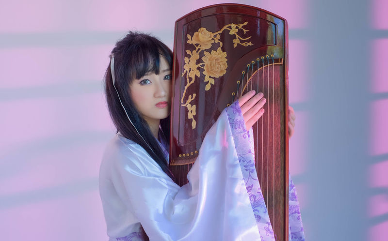 One upon a time Acient Chinese Day Guzheng Musical Instrument Musican One Person Real People Young Adult Young Women