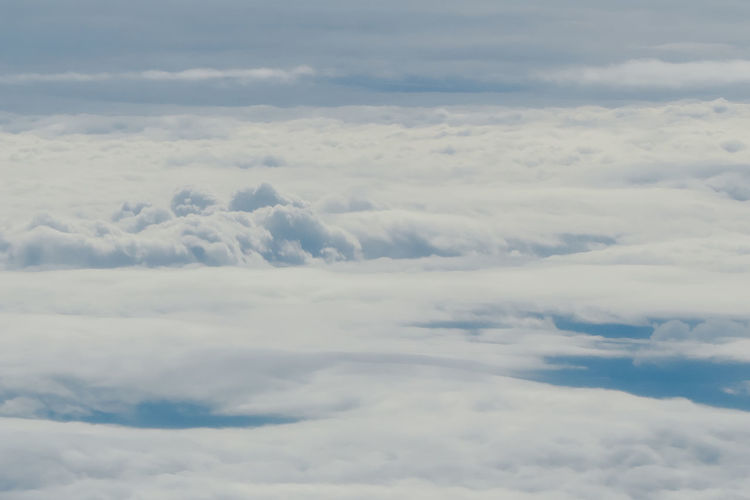 clear blue sky background with white clouds from above Cloud - Sky Beauty In Nature Scenics - Nature Tranquility Sky Tranquil Scene Cloudscape No People Idyllic Nature Day White Color Outdoors Backgrounds Fluffy Meteorology Softness Heaven Aerial View Dramatic Sky Above
