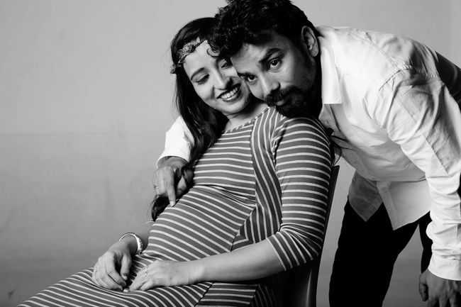 Mother To Be Father To Be EyeEm Selects Child Abdomen Sitting Females Togetherness Childhood Portrait Domestic Life Women Girls Pregnant Maternity Wear Family Bonds Hands On Stomach