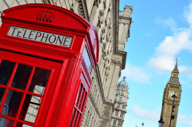 EyeEm LOST IN London Architecture Building Exterior Built Structure City Clock Tower Communication Day Low Angle View No People Outdoors Pay Phone Red Sky Telephone Booth Text