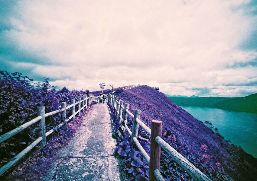 Neon Life Sky Cloud - Sky Scenics Railing Sea Nature Beauty In Nature Water Tranquil Scene Outdoors Day Tranquility No People Landscape Mountain Horizon Over Water Purple Film Lomography